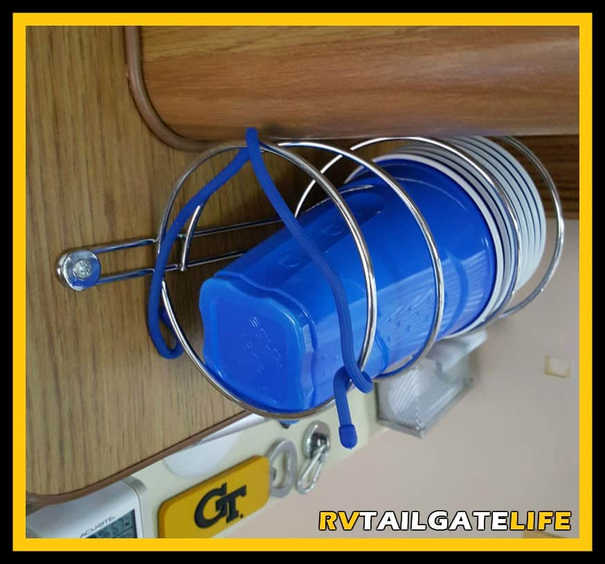 Easy Access to Solo Cups but still out of the way with this easy RV modification using a toilet paper holder in your RV kitchen