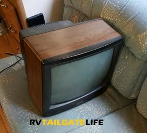 The old TV looks so sad on the couch. Oh well, you are outta here!