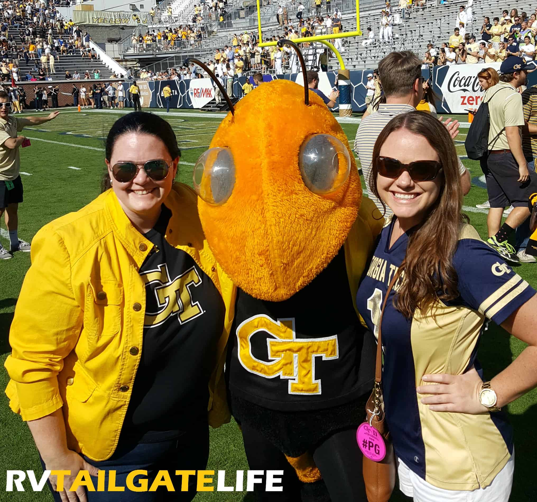 Kimberly and Amanda with Buzz on the field prior to the 2016 Homecoming game vs Duke