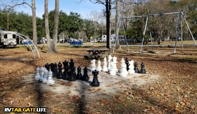 Oak Plantation RV Campground amenities include a large outdoor chess board, a playground, and disc golf