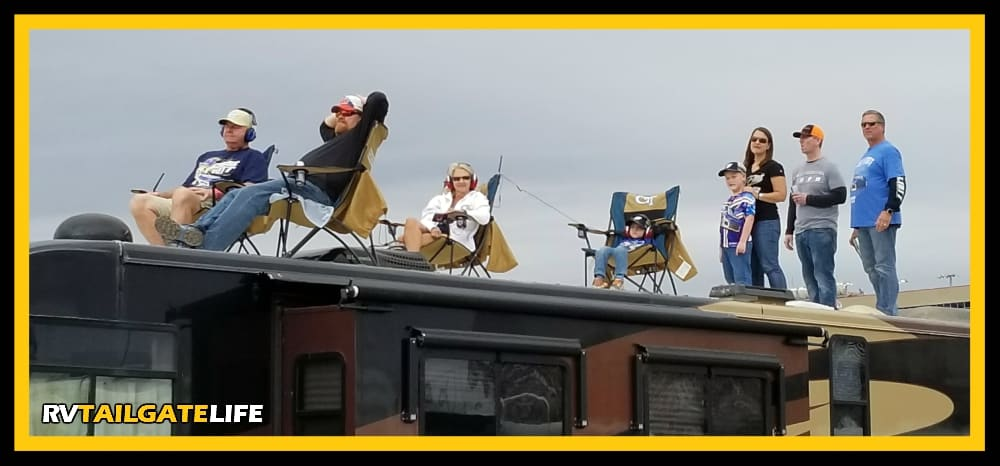 The best view of the NASCAR race is on the top of the RV in the infield.