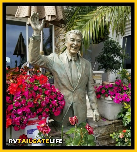 Find the statue of Ronald Reagan on the board walk on Balboa Island