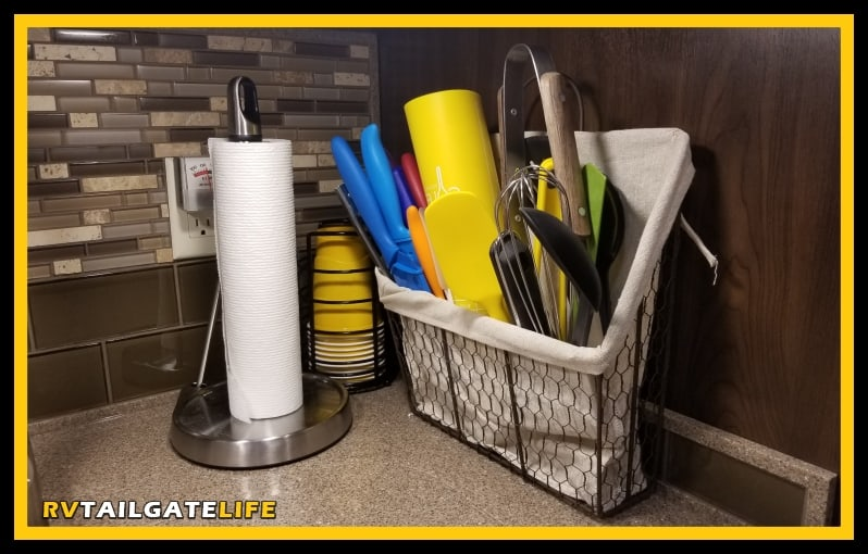 Keep the RV kitchen counter clear with just a few items, like a Solo Cup holder and paper towels.