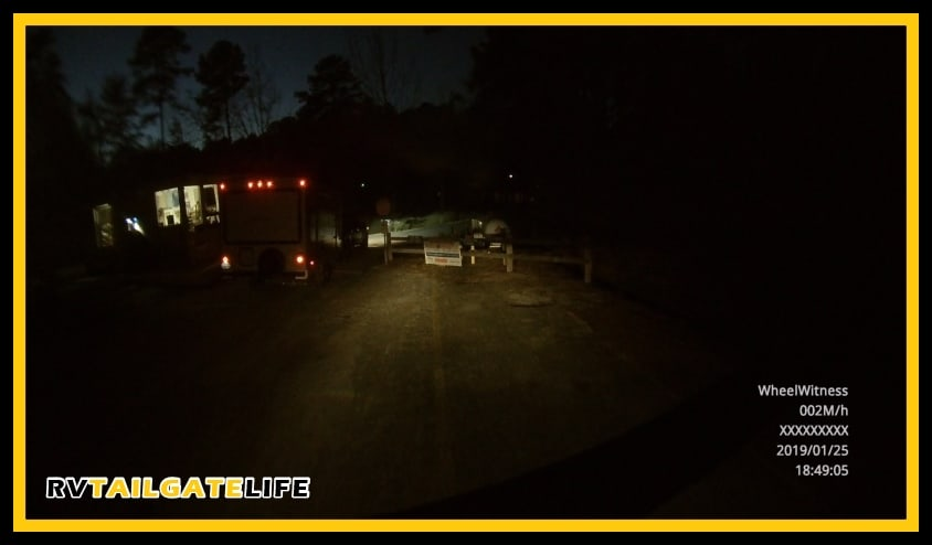 Still shot from the RV dash cam at the entrance to the campgrounds at Oak Mountain State Park at night