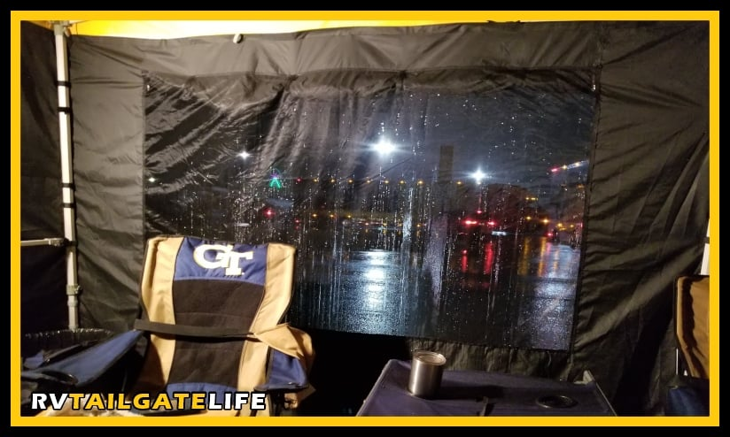 Picture of the best tailgating pop-up tent with the sidewalls, window panel, the frame, and the side rails, at night during the 2019 NASCAR tailgate in Atlanta