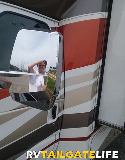 RV Renter looking frustrated in the mirror of the Rental RV
