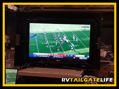 The MyTCase and TV used inside the RV to stream a football game