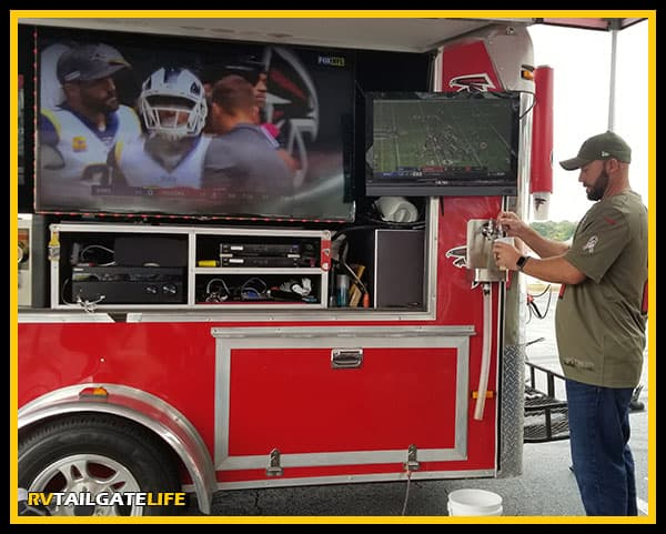Falcons tailgate trailer TVs and beer!