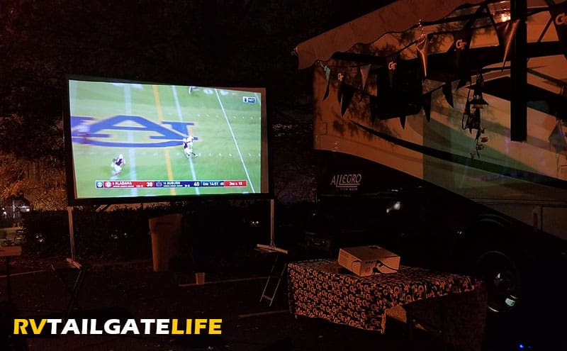 Project the game on a large screen at night for large crowds to watch. Use the ESPN smartphone app to stream football games during the tailgate or the Winegard app to find OTA or satellite signals